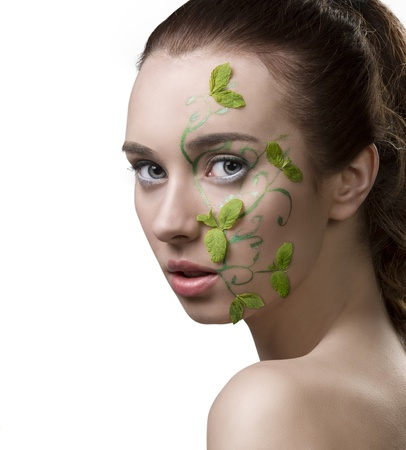 nacked: close-up portrait of pretty girl with nacked shoulders, creative fresh summer make-up with mint leaves