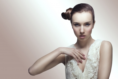 hair tied: pretty girl with brown smooth hair tied in creative hair-style