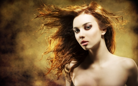 portrait of sensual young girl with brown wavy flying hair and pretty make-up with strong color and grunge background photo