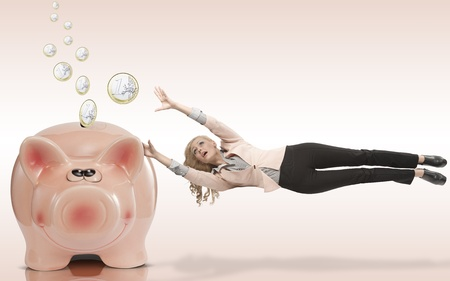 flying woman: elegant business woman is afraid to lose her savings. She flying away and trying to doesn't leave her piggybank