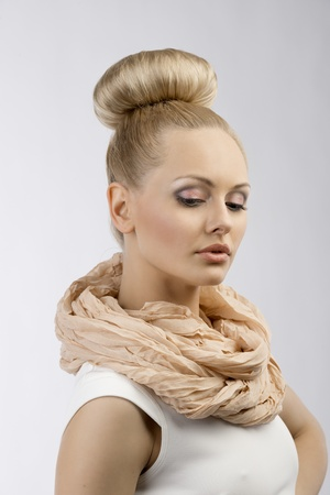 sweetly: blond girl with white dress and up hair style and summer scarf looking down sweetly