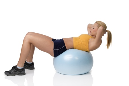 big woman: young pretty woman with gym body , on big ball doing fitness exercise . Natural skin
