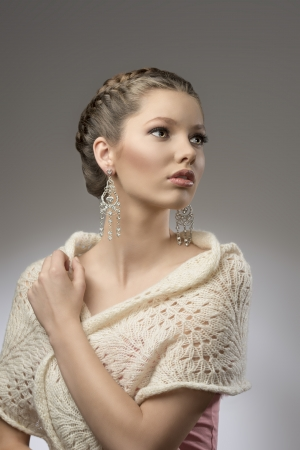 fashion portrait of elegant pretty girl with brown creative hair-style, precious earrings in emotional pose  photo