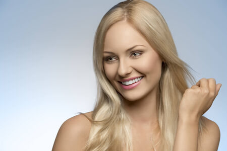 close-up portrait of beauty smiling girl with natural style, perfect skin and smooth blonde hair  photo