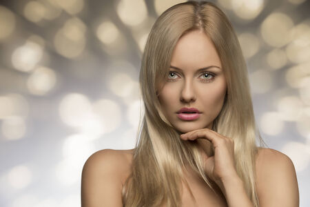 portrait of sensual young woman with naked shoulders, perfect skin and splendid blonde smooth hair  photo