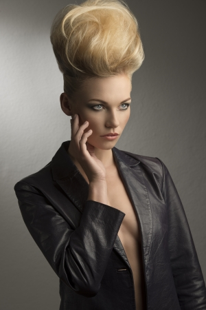 hairdo: portrait of pretty girl with fashion rock look posing with modern  creative hairdo and leather jacket