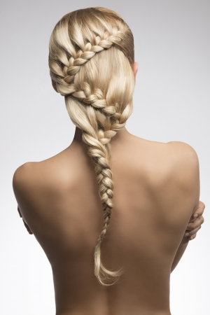 very sexy girl with long braid creative hair-style turned on her sensual naked back  photo