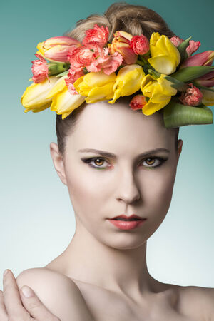 close-up portrait of beauty woman with pure skin, cute make-up and colorful floral garland on the head. Spring atmosphere  photo