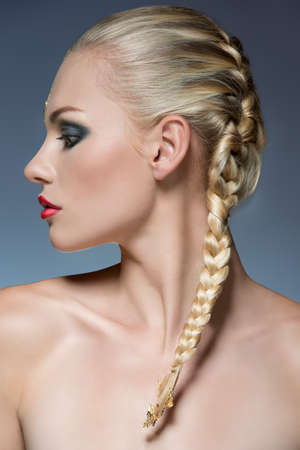 close-up portrait of female profile with creative strong make-up and bride blonde hair-style  photo