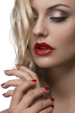 sexy young girl with red lips and nail polish, shiny wavy blonde hair  photo