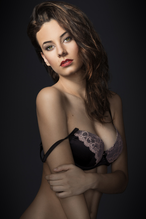 fashion model wearing a nice lace bra lingerie , looking in camera sensual with great hair style photo
