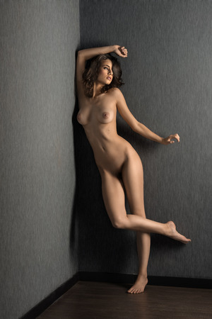 young sexy beautiful girl posing naked in a studio shot with perfect sensual body, looking on one side Stock Photo
