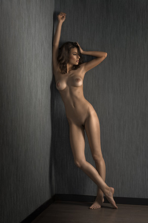 nude women: young sexy beautiful girl posing naked in a studio shot with perfect sensual body Stock Photo