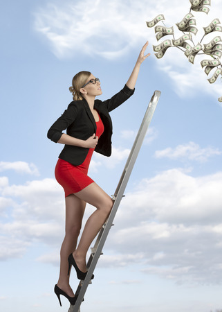 sexy business woman with elegant suit climbing ladder with ambition  Stock Photo