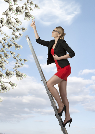 ambitious business woman climbing ladder for success  photo