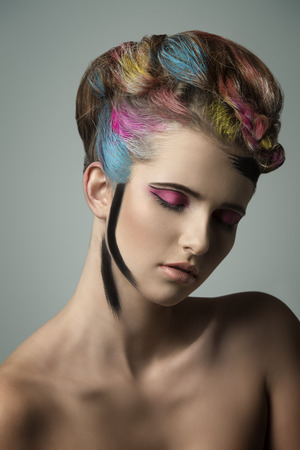 crazy hair: gorgeous colorful beauty portrait of young girl with multicolor painted hair-style and cute make-up  Stock Photo
