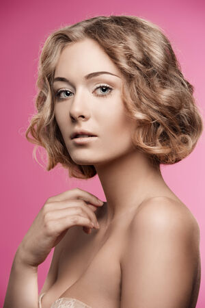 silky hair: sensual woman posing in beauty portrait with short curly silky hair and natural make-up. Perfect skin