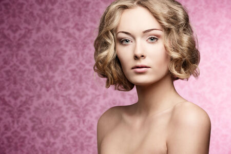 cute young girl with natural look posing in beauty portrait with short curly hair-cut and perfect skin  photo