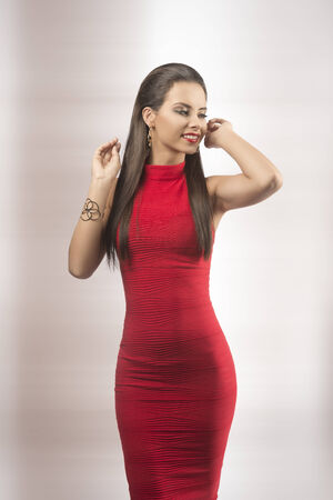 happy woman with long brown girl posing with elegant red dress and golden jewellery christmas - Red Dress For Christmas Party