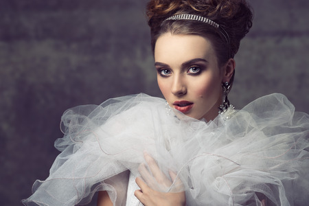 a frill: creative fashion shoot with romantic retro atmosphere of sensual elegant girl with precious jewellery, antique dress with frill veil collar and charming make-up Stock Photo