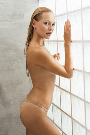 aqua naked: Pretty, healthy, sexy, feresh woman with long blonde, wet hair after shower. She has got natural make up and she is looking at camera.