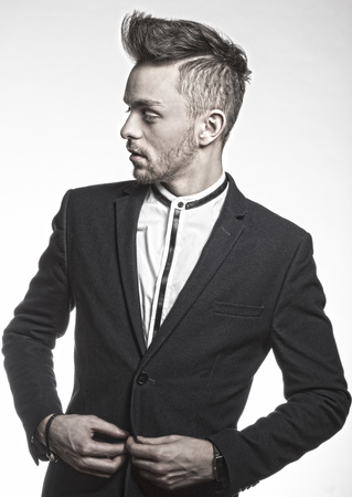 white suit: turned in HDR black and white portrait ,fashion young model male , wearing a trendy black suit , with white shirt he is looking on one side