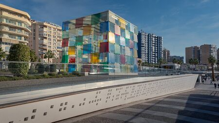 Malaga Pompidou Centre exterior - Multi colored glasses building in Quay 1 of the Port of Malaga. Daylight panorama shot with blue sky.