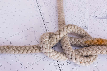 seafaring: nautical knots photographed on nautical map
