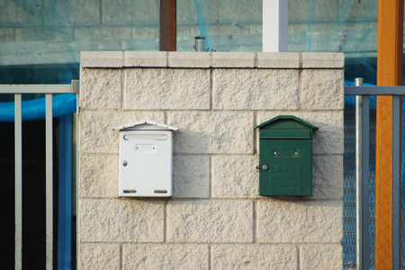 usps: White and green mailboxes on industrial building