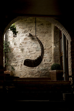 spello: Wicker hammock in the old town of Spello - Umbria Italy