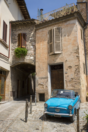 spello: The famous old Italian small car in the ancient village of Spello in Tuscany Italy