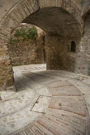 spello: Narrow streets of the medieval village of Spello in Umbria Italy