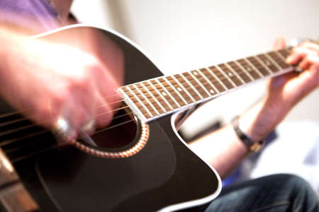 interpret: young man playing acoustic guitar Stock Photo