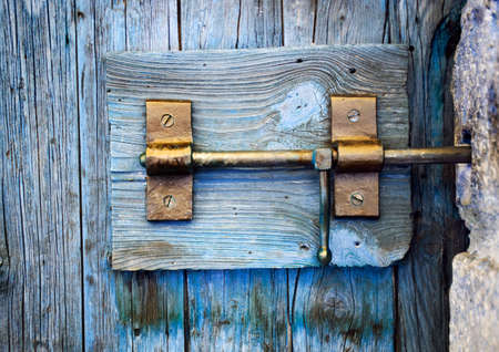 detail of a lock of a wooden door photo