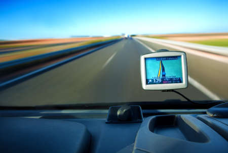 dash: Close up image of gps in a car and road Stock Photo