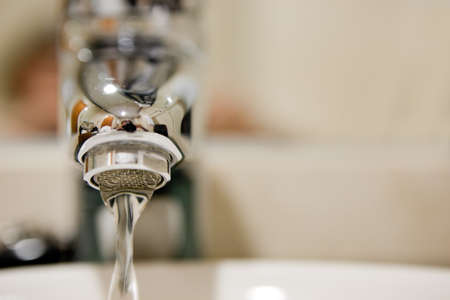 close up image of tap and water photo