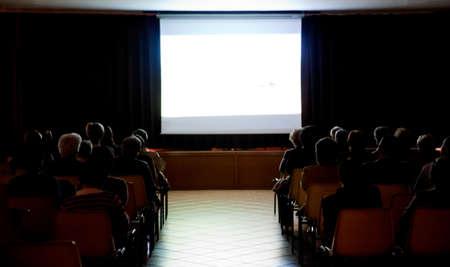 public in a small theater photo