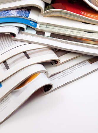 Detail of several magazines and books isolated in white photo