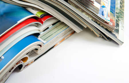 Detail of several magazines and books isolated in white