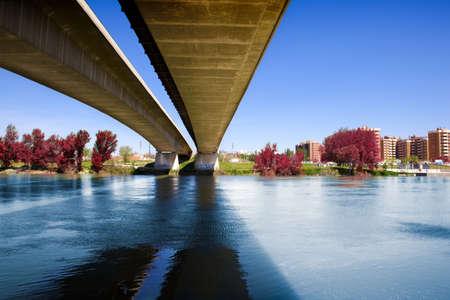 architectural image of concrete bridge and river photo