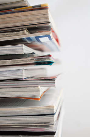 Close up image of several magazines and books photo