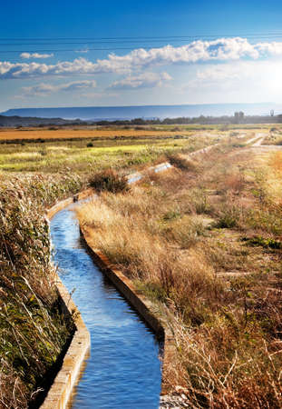 Rural landscape with irrigation  channel and fields Stock Photo - 8462493