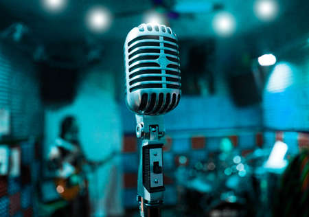 Abstract background music with vintage microphone and musicians photo