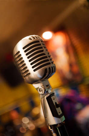 Music background with close up image of retro microphone photo