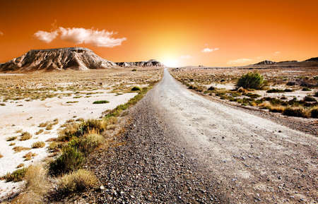 Sunset desert landscape with road photo