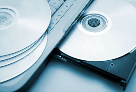 Close up image of computer and cd and dvd photo