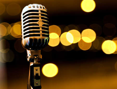 old microphone: Musical background with microphone and stage lights