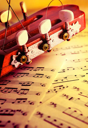 Classical musical background with acoustic guitar and music score Stock Photo - 9301575
