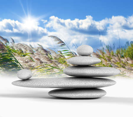 Zen concept with balanced rocks,sky and nature background photo