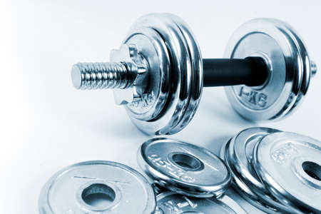 Gymnastics background with weights or dumbbells isolated in white Stock Photo - 9301577